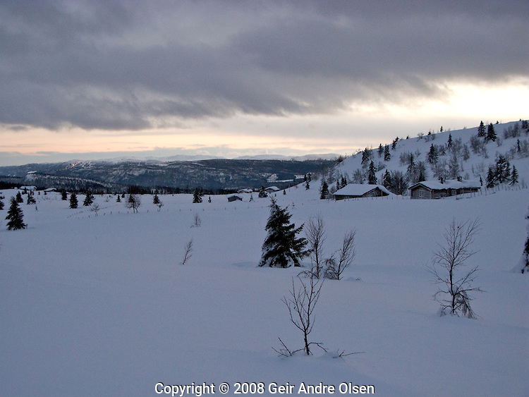 Old farm with Kvitfjell olympic downhill arena from Lillehammer, Norway, in background