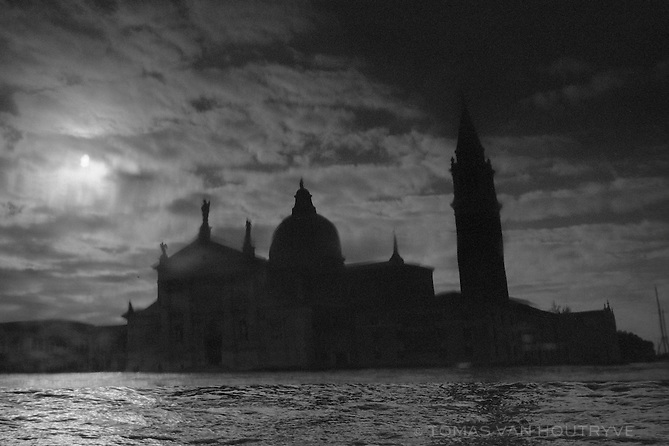The skyline of Venice, Italy is seen in the reflection of the roof a boat on Dec. 30, 2010.