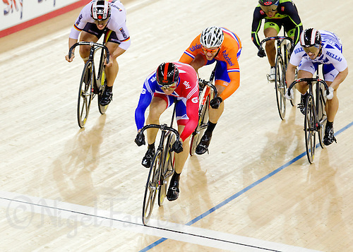 18 FEB 2012 - LONDON, GBR -Great Britain's Sir Chris Hoy (GBR) (in blue and red) leads during the second round of the Men's Keirin at the UCI Track Cycling World Cup and London Prepares test event for the 2012 Olympic Games in the Olympic Park Velodrome in Stratford, London, Great Britain (PHOTO (C) 2012 NIGEL FARROW)
