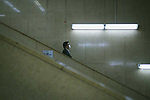 A man wearing a mask is alone on escalator on the day of Japan's Prime Minister lift of the state of emergency in Tokyo and the remaining 5 areas still under alert for the coronavirus disease (COVID-19) at Shinjuku district in Tokyo, Japan May 25, 2020. May 25, 2020 (Photo by Nicolas Datiche/AFLO) (JAPAN) FRANCE OUT