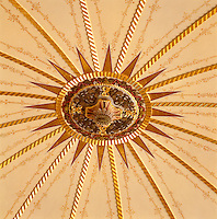 Detail of the elaborately carved and painted ceiling boss at the centre of the domed in the hall landing