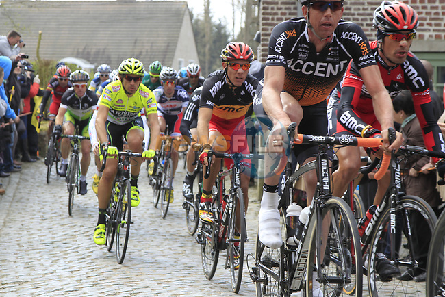 The peloton including Manuel Quinziato (ITA) and Philippe Gilbert (BEL) BMC Racing Team and Filippo Pozzato (ITA) Farnese Vini-Selle Italia climb Molenberg during the 96th edition of The Tour of Flanders 2012, running 256.9km from Bruges to Oudenaarde, Belgium. 1st April 2012. <br /> (Photo by Eoin Clarke/NEWSFILE).