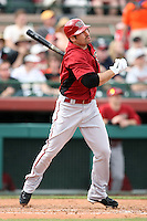 Xavier Nady #22 of the Arizona Diamondbacks hits the first Diamondbacks homerun of the year against the San Francisco Giants in the first spring training game of the season at Scottsdale Stadium on February 25, 2011  in Scottsdale, Arizona. .Photo by:  Bill Mitchell/Four Seam Images.