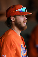 Right fielder Seth Beer (28) of the Clemson Tigers watches from the dugout in a game against the William and Mary Tribe on February 16, 2018, at Doug Kingsmore Stadium in Clemson, South Carolina. Clemson won, 5-4 in 10 innings. (Tom Priddy/Four Seam Images)