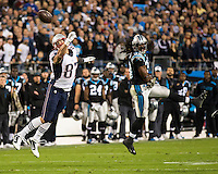 The Carolina Panthers play the New England Patriots at Bank of America Stadium in Charlotte North Carolina on Monday Night Football.  The Panthers defeated the Patriots 24-20.  New England Patriots tight end Rob Gronkowski (87) stretches for a pass over Carolina Panthers strong safety Robert Lester (38)