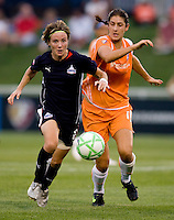 Washington Freedom midfielder (8) Sonia Bompastor sprints away from  Sky Blue FC midfielder (10) Yael Averbuch at the Maryland SoccerPlex in Boyds, Maryland.  The Washington Freedom defeated Sky Blue FC, 3-1, to secure a place in the playoffs.