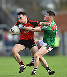 Gearoid O Connell of Clondegad in action against Keelan Sexton of Kilmurry Ibrickane during their senior county final at Cusack park. Photograph by John Kelly.