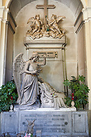 Picture and image of the stone sculpture of an angel blessing the deceased lying on a chez longue. Bonini Tomb sculpted by D Carli 1891. Section A, no 27, The monumental tombs of the Staglieno Monumental Cemetery, Genoa, Italy
