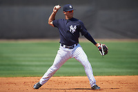 New York Yankees Wilkerman Garcia (5) throws to first base during a minor league Spring Training game against the Detroit Tigers on March 22, 2017 at the Yankees Complex in Tampa, Florida.  (Mike Janes/Four Seam Images)