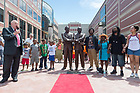 "June 21, 2017; Members of the community hold hands and sing ""We Shall Overcome,""  with local artist Tuck Langland after the unveiling of the new sculpture of the Rev. Theodore M. Hesburgh and the Rev. Martin Luther King in downtown South Bend.  (Photo by Barbara Johnston/University of Notre Dame)"