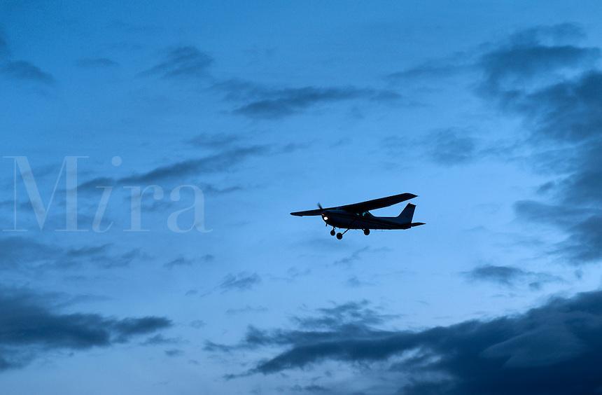 Small jet airlpane in flight.