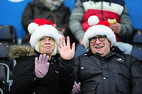 Swansea City fans in action during the Sky Bet Championship match between Swansea City and Middlesbrough at the Liberty Stadium in Swansea, Wales, UK. Saturday 14 December 2019