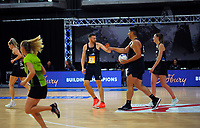 Daniel Jeffries and Junior Levi celebrate during the Cadbury Netball Series match between NZ Silver Ferns and NZ Men at the Fly Palmy Arena in Palmerston North, New Zealand on Thursday, 22 October 2020. Photo: Dave Lintott / lintottphoto.co.nz