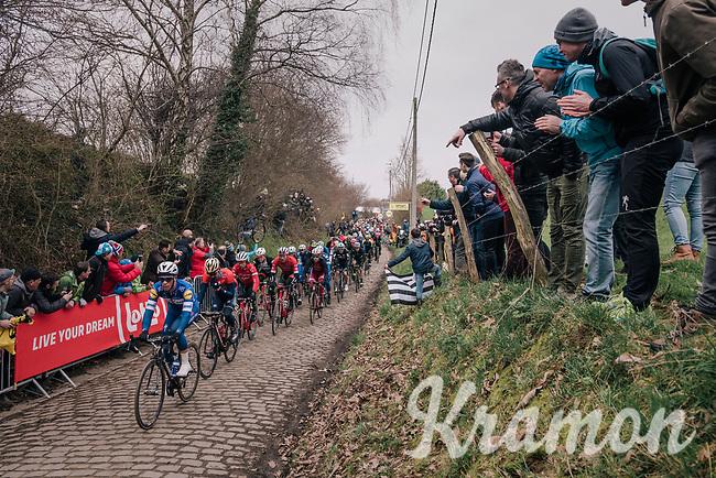 peloton led by Iljo Keisse (BEL/Quick-Step floors) over the Oude Kwaremont<br /> <br /> 102nd Ronde van Vlaanderen 2018 (1.UWT)<br /> Antwerpen - Oudenaarde (BEL): 265km