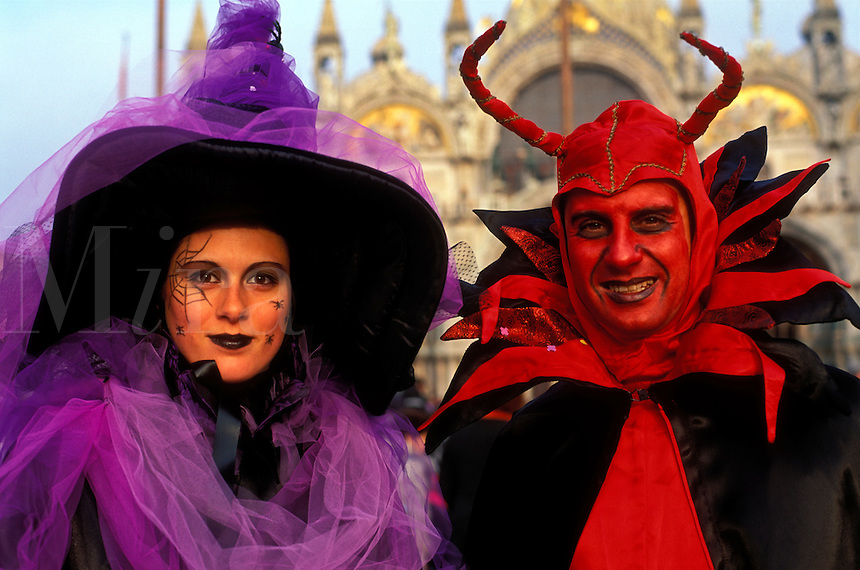 Italy, Venice, Piazza San Marco at Carnevale (Carnival) with revellers dressed in costume
