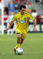 Columbus Crew forward Guillermo Barros Schelotto (7) dribbles the ball.  The Chicago Fire tied the Columbus Crew 0-0 at Toyota Park in Bridgeview, IL on July 11, 2009.