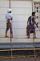 Myanmar, Burma, Yangon.  Men Working on Bamboo Scaffolding.