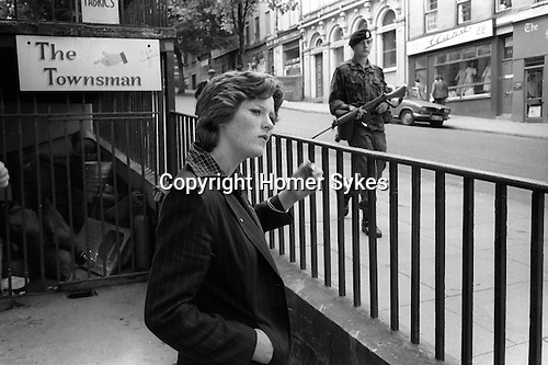 Derry Northern Ireland Londonderry. 1979. British soldiers on patrol city centre streets.