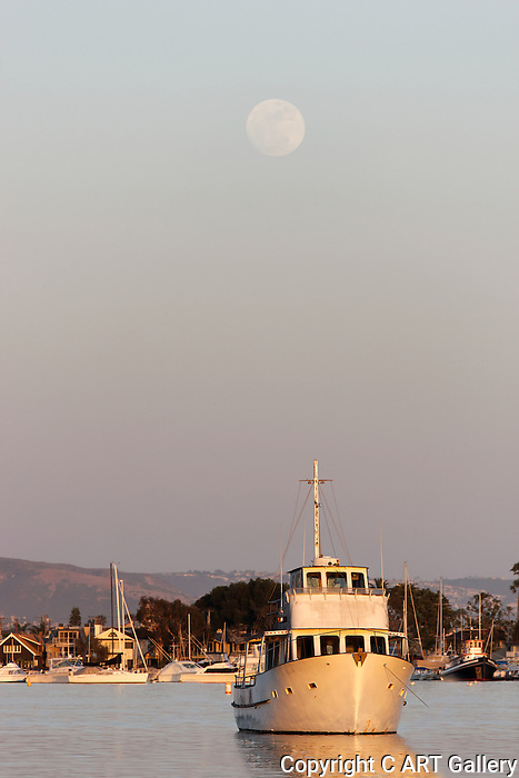 Sunset with moon over Lido Island, CA.