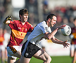 Joe Dowling of Ennistymon in action against Aidan Mc Guane of  St. Joseph's Miltown during the county senior football final at Cusack Park. Photograph by John Kelly.