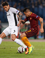 Calcio, Europa League: Roma vs Astra Giurgiu. Roma, stadio Olimpico, 29 settembre 2016.<br /> Roma's Juan Iturbe, right, is challenged by Astra Giurgiu's Fabricio during the Europa League Group E soccer match between Roma and Astra Giurgiu at Rome's Olympic stadium, 29 September 2016. Roma won 4-0.<br /> UPDATE IMAGES PRESS/Riccardo De Luca
