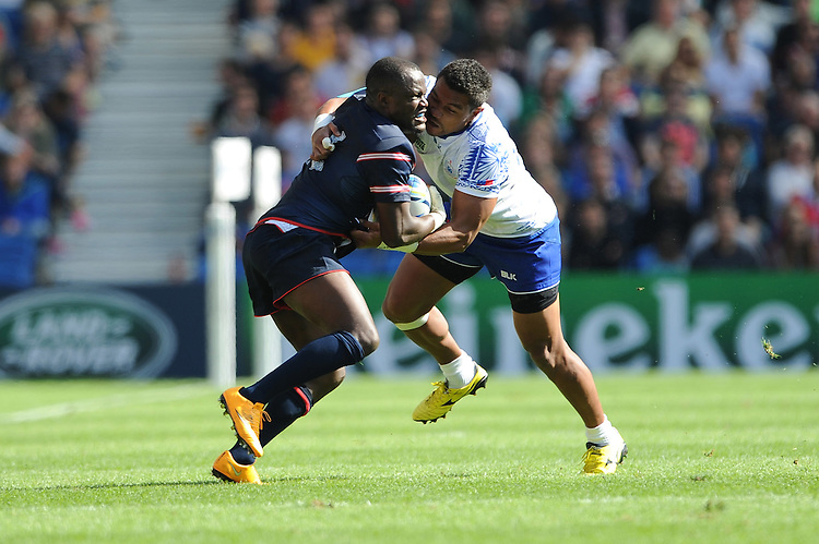 Takudzwa Ngwenya of USA tussles with Fa'atoina Autagavaia of Samoa during Match 6 of the Rugby World Cup 2015 between Samoa and USA - 20/09/2015 - Brighton Community Stadium, Brighton <br /> Mandatory Credit: Rob Munro/Stewart Communications