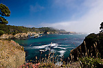 Surf surges into a foggy cove near Salt Point.  North of Bodega Bay along the California coastline and famous U.S. Highway 1 lie many wonderful beach accesses, headlands, and state parks along with pastoral and mountain views inland.