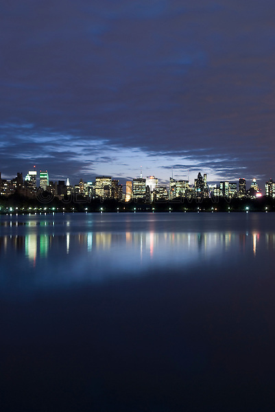 AVAILABLE FROM JEFF AS A FINE ART PRINT.<br /> <br /> AVAILABLE FROM PLAINPICTURE FOR COMMERCIAL AND EDITORIAL LICENSING.  Please go to www.plainpicture.com and search for image # p5690189.<br /> <br /> Manhattan Skyline at Night Viewed From The Central Park Reservoir, Central Park, New York City, New York State, USA