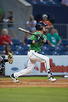 Drew Waters (11) of the Gwinnett Stripers follows through on his swing against the Scranton/Wilkes-Barre RailRiders at Coolray Field on August 16, 2019 in Lawrenceville, Georgia. The Stripers defeated the RailRiders 5-2. (Brian Westerholt/Four Seam Images)