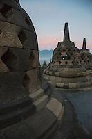Borobudur, Java, Indonesia.  Stupas and Full Moon just before Sunrise.
