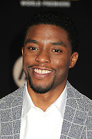 """14 December 2015 - Hollywood, California - Chadwick Boseman. """"Star Wars: The Force Awakens"""" Los Angeles Premiere held at multiple theaters on Hollywood Blvd. Photo Credit: Byron Purvis/AdMedia"""