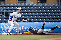Max Miller (5) of the Duke Blue Devils prepares to put the tag on Aaron Knapp (23) of the California Golden Bears in the top of the first inning at Durham Bulls Athletic Park on February 20, 2016 in Durham, North Carolina.  The Blue Devils defeated the Golden Bears 6-5 in 10 innings.  (Brian Westerholt/Four Seam Images)