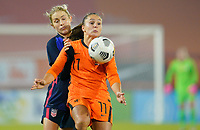 BREDA, NETHERLANDS - NOVEMBER 27: Abby Dahlkemper #7 of the United States battles with Lieke Martens #11 of the Netherlands during a game between Netherlands and USWNT at Rat Verlegh Stadion on November 27, 2020 in Breda, Netherlands.