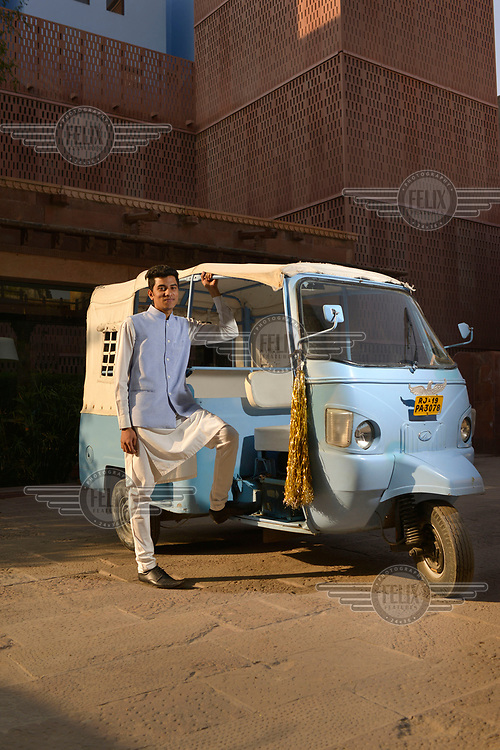 A member of staff and the personalised auto-rickshaw belonging to The Raas, luxury Heritage Hotel, constructed on the site of an original 300-year old Haveli (private palace) and incorporating local and traditional materials in its minimalist, modern design.
