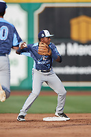 West Michigan Whitecaps second baseman Alexis Garcia (7) turns a double play during a game against the Fort Wayne TinCaps on May 17, 2018 at Parkview Field in Fort Wayne, Indiana.  Fort Wayne defeated West Michigan 7-3.  (Mike Janes/Four Seam Images)