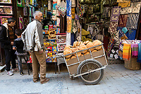 Fes, Morocco.  A Bread Vendor and his Cart in the Medina.