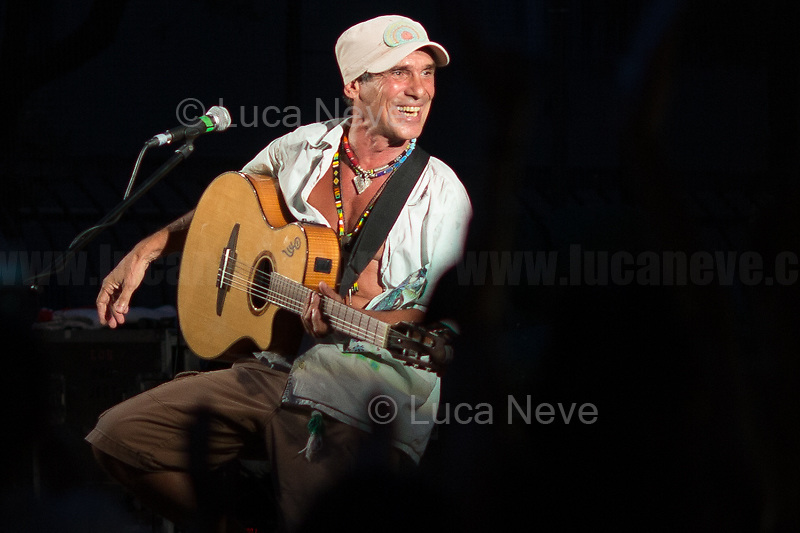 """Manu Chao / El Chapulin Solo Concert in the Luzzati's Gardens.<br /> <br /> Genoa, Italy. 19, 20, 21 July 2021. Twenty years after the dramatic and terrifying events related to the 2001 Genoa's G8 meeting, according to Amnesty International: """"the most serious suspension of democratic rights in a Western country since the Second World War"""" (1.) and as stated on the 2001 """"Report on the situation of fundamental rights in the EU"""" the European Parliament """"deplores the suspensions of fundamental rights that took place during public demos, and in particular at the G8 meeting in Genoa, such as freedom of expression, freedom of movement, the right to physical integrity"""" (2.). As a reminder, the City of Genoa is State Gold Medal (Medaglia D'Oro) for its Antifascist Resistance in World War II.<br /> Some photos, part of this story, are presented appositely in Black & White to show to the audience """"the Places"""" where the majority of - the already mentioned (see above) - """"suspensions of fundamental rights […] such as freedom of expression, freedom of movement, the right to physical integrity"""" (2.) happened.<br /> In these three days, throughout a series of events, Genoa and its People, survivors and witnesses, experts and activists, remembered what happened 20 years ago, discussed the present situation of a world dominated by """"casino capitalism"""", predatory neo-liberalism, wars, rightless globalization, ...<br /> <br /> FULL CAPTION AT THE BEGINNING OF THIS STORY.<br /> <br /> Footnotes, Links:<br /> 1. http://bit.do/fRvdg<br /> 2. http://bit.do/fRvdi<br /> 3. http://bit.do/fRvdj<br /> 4. http://bit.do/fRvdn<br /> 5. http://bit.do/fRvdo<br /> 6. http://bit.do/fRvdr<br /> 7. http://bit.do/fRvdt & http://bit.do/fRvdu<br /> 8. http://bit.do/fRvdv & http://bit.do/fRvdw & http://bit.do/fRvdx<br /> 9. http://bit.do/fRvdz<br /> 10. http://bit.do/fRvdA<br /> 11. http://bit.do/fRvdB<br /> http://www.veritagiustizia.it/doc_eng/<br /> https://www.carlogiuliani.it<br /> https://en.wikipedia.o"""