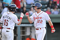 Third baseman Mitchell Gunsolus (22) of the Greenville Drive is congratulated by Tate Matheny (16) after hitting a home run in a game against the Augusta GreenJackets on Wednesday, May 4, 2016, at Fluor Field at the West End in Greenville, South Carolina. Greenville won, 6-3. (Tom Priddy/Four Seam Images)