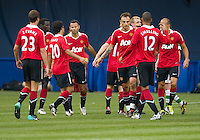 July 16, 2010 Manchester United players celebrate a goal during an international friendly between Manchester United and Celtic FC at the Rogers Centre in Toronto.