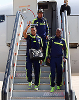 Wednesday 18 September 2013<br /> Pictured: Players Jonathan de Guzman (TOP), Michel Vorm (L) and Dwight Tiendalli (R) disembark from the aeroplane upon their arrival to Valencia, Spain.<br /> Re: Swansea City FC players and staff travelling to Spain for their UEFA Europa League game against Valencia.