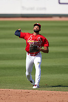 St. Louis Cardinals shortstop José Rondón (64) throws to first base during a Major League Spring Training game against the Houston Astros on March 20, 2021 at Roger Dean Stadium in Jupiter, Florida.  (Mike Janes/Four Seam Images)