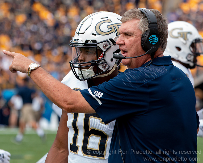 Georgia Tech Yellow Jackets quarterback TaQuon Marshall gets instruction from head coach Paul Johnson. The Pitt Panthers football team defeated the Georgia Tech Yellow Jackets 24-19 on September 15, 2018 at Heinz Field in Pittsburgh, Pennsylvania.
