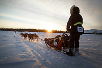 Anna Berington on the trail heading towards the Finger Lake checkpoint at sunrise during the 2019 Iditarod on Monday March 4, 2019.<br /> <br /> Photo by Jeff Schultz/  (C) 2019  ALL RIGHTS RESERVED