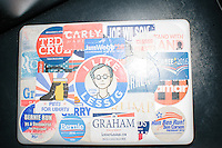 """Campaign stickers from various 2016 candidates, including a sticker reading """"I Like Lessig,"""" adorn a journalist's computer resting on a seat after Harvard Law professor and Democratic presidential candidate Lawrence Lessig spoke at a meeting of the Salem Democrats at The Colosseum Restaurant in Salem, NH. This campaign event was Lessig's first visit to New Hampshire, though he had not yet raised the $1 million he wanted to raise before officially declaring his candidacy. The following week, Lessig raised the money and declared his candidacy. Lessig is running an unusual campaign, calling himself a """"referendum candidate."""" He has said his campaign will focus on a single issue, The Citizen Equality Act, which would reform campaign financing, gerrymandering, and access to voting. Lessig has pledged that, if elected, once the Citizen Equality Act becomes law, he will immediately resign and turn the presidency over to his vice president."""
