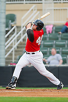 Dan Black #40 of the Kannapolis Intimidators follows through on his swing against the West Virginia Power at Fieldcrest Cannon Stadium on April 21, 2011 in Kannapolis, North Carolina.   Photo by Brian Westerholt / Four Seam Images
