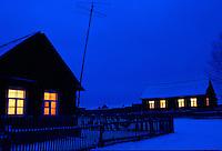 Rural houses on winter night..