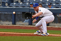 Tulsa Drillers Paul Hoenecke (14) takes a throws at first base during the game against the Northwest Arkansas Naturals at Oneok Field on May 2, 2016 in Tulsa, Oklahoma.  Northwest Arkansas won 9-6.  (Dennis Hubbard/Four Seam Images)