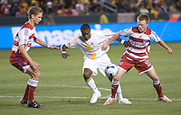 LA Galaxy FWD Robbie Findley battles FC Dallas DEF Clarence Goodson (left) and MID Dax McCarty (Right) for a loose ball during a MLS match. FC Dallas beat the LA Galaxy 2-1 at the Home Depot Center in Carson, California, Thursday April 12, 2007.