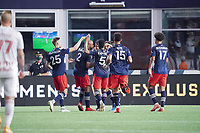 FOXBOROUGH, MA - MAY 22: New England Revolution celebrate their goal against New York Red Bulls during a game between New York Red Bulls and New England Revolution at Gillette Stadium on May 22, 2021 in Foxborough, Massachusetts.