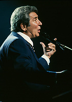August 1994 file photo, Montreal, Quebec, Canada<br /> <br /> French singer Gilbert Becaud plays the piano at his concert at the St-Denis Theater, during the Francofolies Festival in Montreal, Canada, August 1994.<br /> <br /> Born as Francois Silly in Toulon, France in 1927<br /> He use the stage name Gilbert Becaus and was nicknamed Mister 100 000 Volts because of his unusaual energy during his concerts. He  died in 2001<br />  <br /> <br /> Mandatory Credit: Photo by Pierre Roussel- Images Distribution. (©) 1994 Copyright by Pierre Roussel <br /> ON SPEC<br /> NOTE 35mm slide scanned with Kodak RFS 3600,saved in Adobe 1998 RGB.